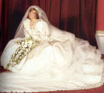The gown was made of ivory silk with a 25-foot train, adorned with antique lace and 10,000 mother-of-pearl sequins.